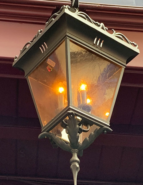 Metal and glass light fixture at 21 Royal in New Orleans Square Disneyland