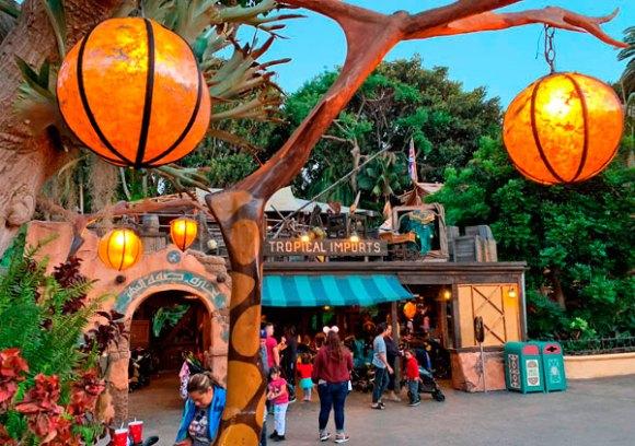 Two hanging orange light fixtures on the main pathway through Adventureland in Disneyland