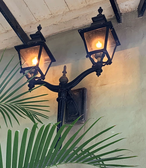 Double light fixture on wall near Cafe Orleans in New Orleans Square Disneyland