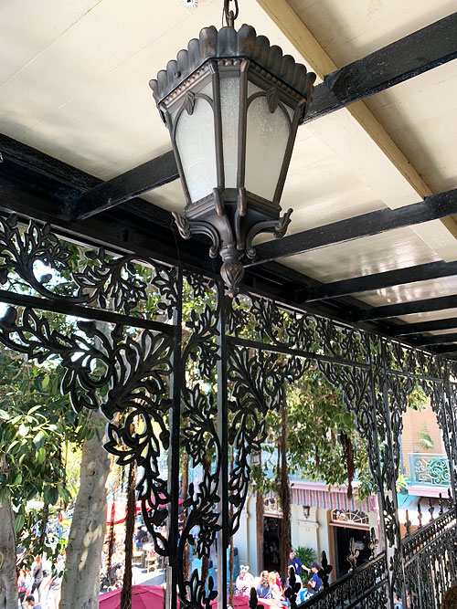 Ceiling light fixture hanging in the outdoor balcony at Disneyland Club 33 New Orleans Square