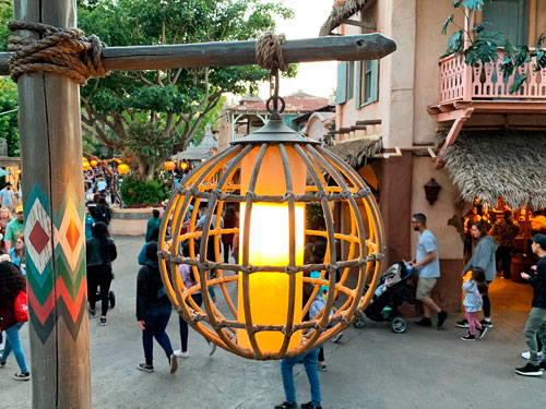 Hanging sphere with faux candle light fixture in common area of Adventureland in Disneyland