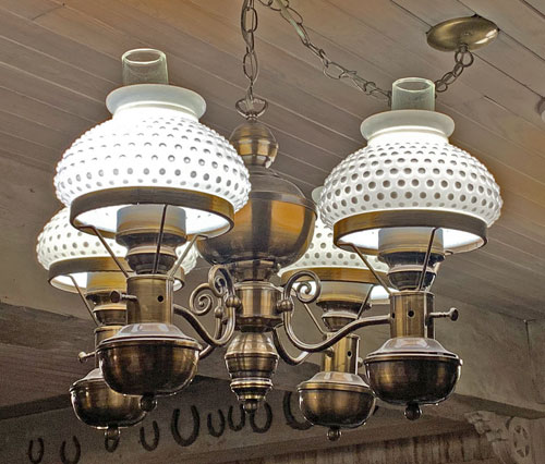 Old west style light fixture in Crockett and Russel Hat Co in Disneyland Frontierland