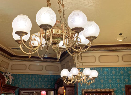 White glass chandeliers in Crystal Arts Store on Main Street USA Disneyland