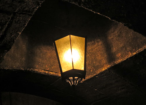 Dim lamp or lantern near exit from Haunted Mansion in New Orleans Square Disneyland