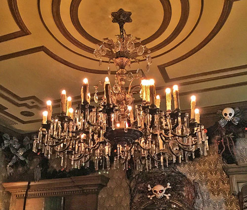 Candle like chandelier in Haunted Mansion Foyer Room in New Orleans Square Disneyland