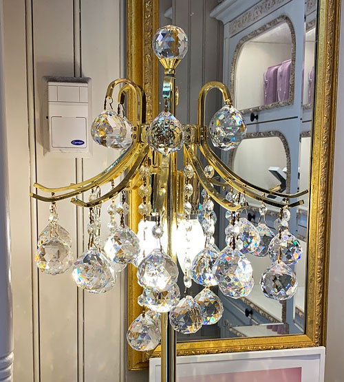 Crystal and gold light fixture in La Mascarade d'Orleans Store in New Orleans Square Disneyland
