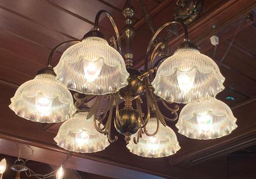 Translucent glass chandelier in Le Bat en Rouge Shop Disneyland