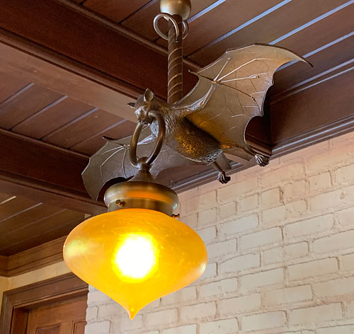 Clever bat in flight light fixture in Le Bat en Rouge shop in New Orleans Square Disneyland