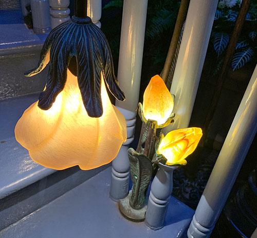 Light fixtures shaped like flowers on Court of Angels stairway in Disneyland Club 33