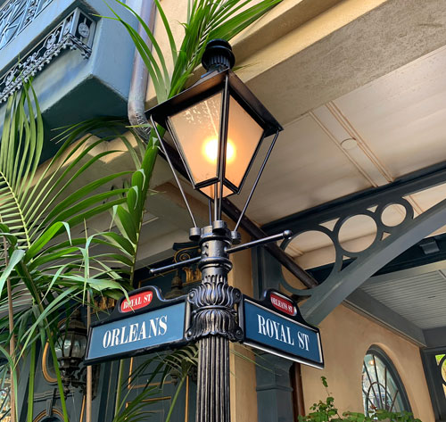 Lighted lamppost at corner of Orleans and Royal Streets in New Orleans Square Disneyland