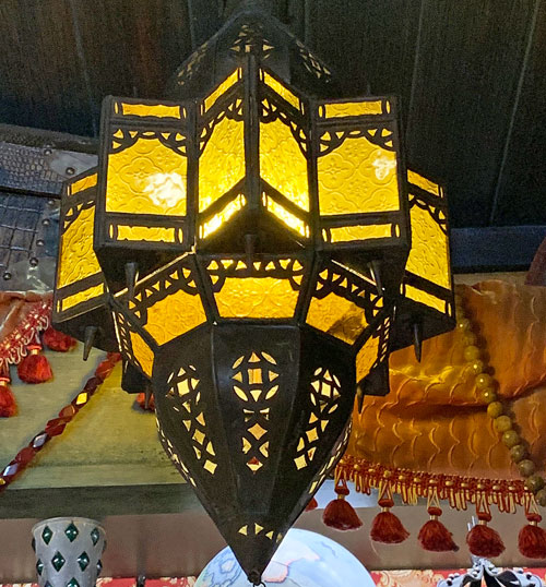 Yellow metal and glass light fixture in Pieces of Eight Shop in New Orleans Square Disneyland