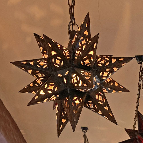 Star shaped brown light fixture at Rancho del Zocalo Restaurant in Disneyland Frontierland