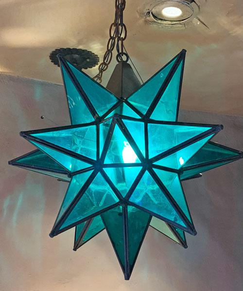 Blue star shaped light fixture at Rancho del Zocalo Restaurant in Disneyland Frontierland