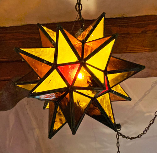 Multicolored star shaped light fixture at Rancho del Zocalo Restaurant in Disneyland Frontierland