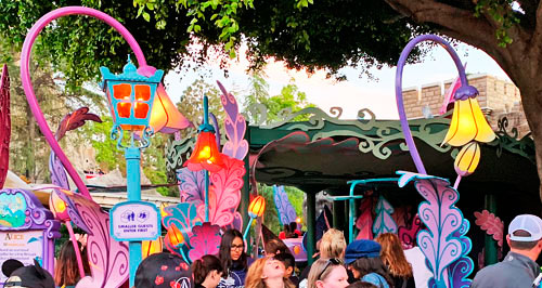 Two colorful curved flower light fixtures at Alice in Wonderland attraction in Disneyland