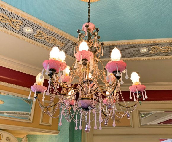 Pink and frosted glass chandelier in the Candy Palace Store on Main Street USA in Disneyland Anaheim California