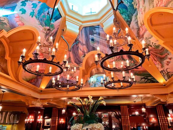 Four chandelier light fixtures hanging from ceiling of the Carthay Circle Restaurant in Disney California Adventure Park in Disneyland
