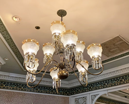 Glass chandelier hanging from ceiling of China Closet Store on Main Street USA in Disneyland