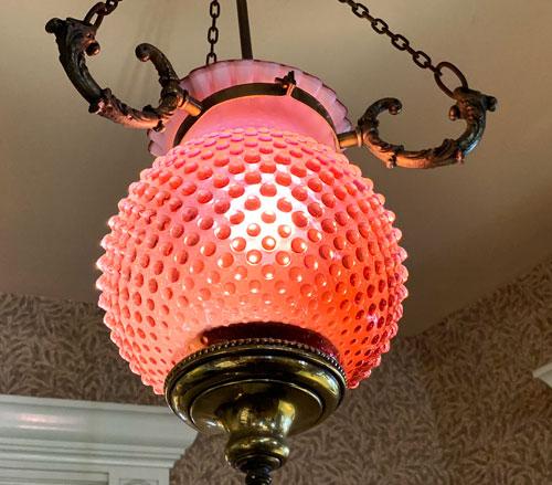 Pink glass globe light fixture at China Closet Store on Main Street USA Disneyland CA