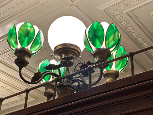 Green and white globe light fixture in French Market Restaurant in New Orleans Square Disneyland