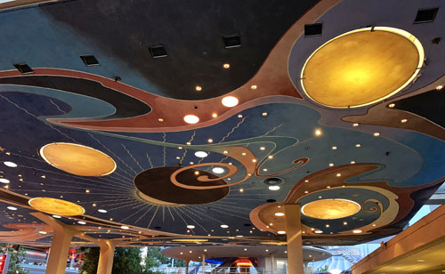 Space age themed ceiling lights and ceiling art at Galactic Grill in Tomorrowland Disneyland CA