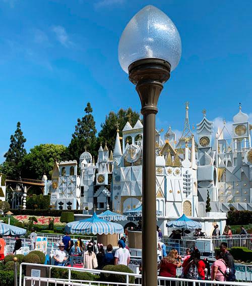 Single tulip shaped light fixture on lamppost near It's a Small World attraction in Disneyland