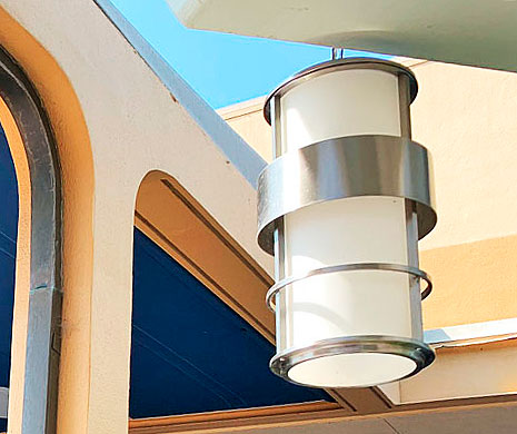 Cylinder shaped metal and glass light fixture in space age design in Tomorrowland Disneyland