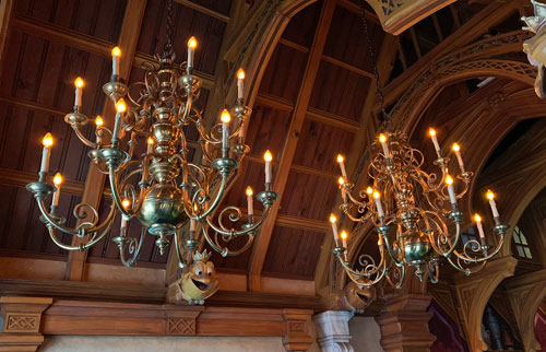 Twin chandeliers in foyer of Mr Toad's Wild Ride attraction in Fantasyland Disneyland