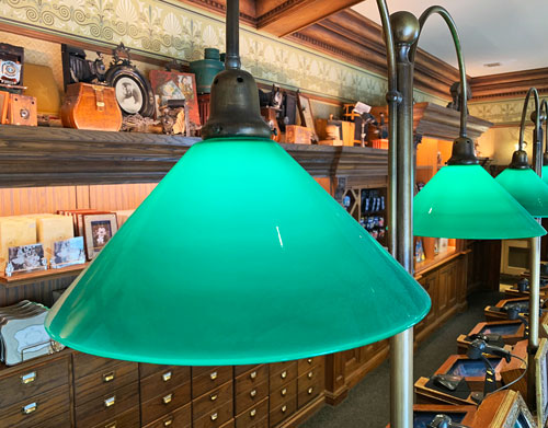 Green glass shade light fixture at Photo Supply Co on the Central Hub in Disneyland CA