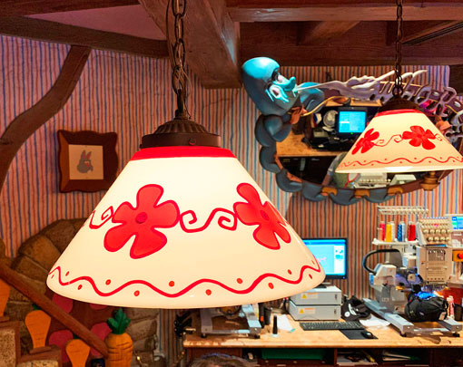 Red and white lampshade light fixtures in The Mad Hatter Shop in Fantasyland Disneyland