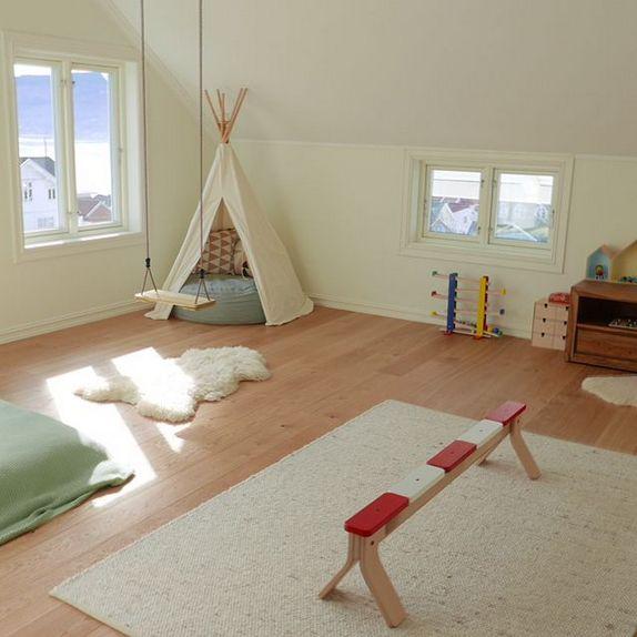 swing and balance beam in Montessori playroom
