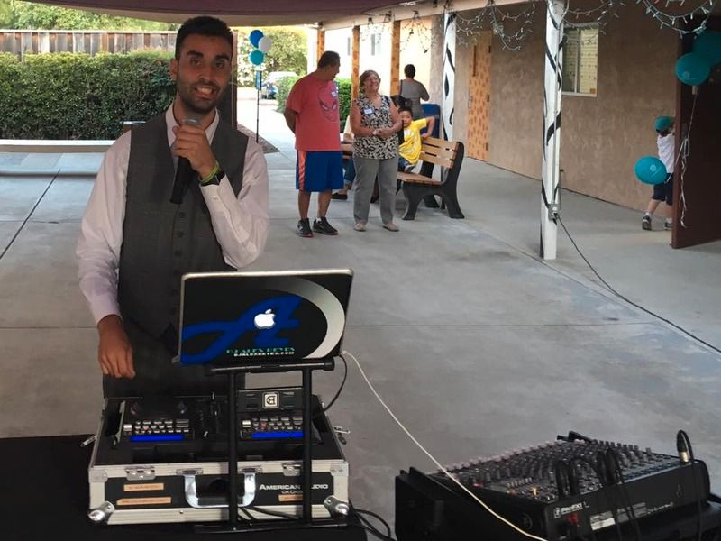 DJ Alex Reyes performing at a Community Event