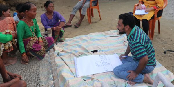 Ram Bastakoti conducts a focus group discussion with community members of Kuti, Kailali.