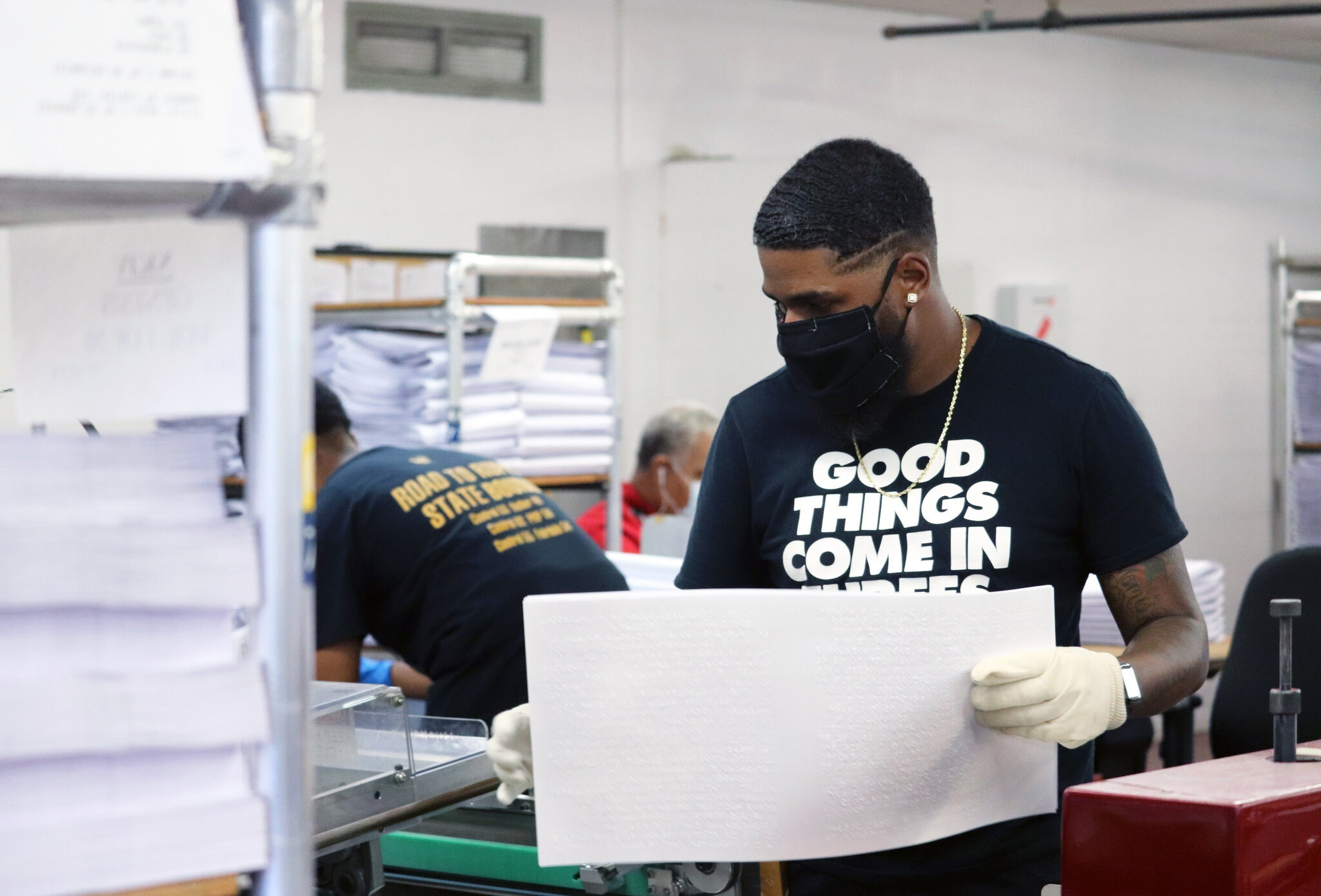 [Image description: A man wearing a black mask and latex gloves helps produce pages in Braille.] The Clovernook Center for the Blind & Visually Impaired is creating a Braille edition of The Times's special section on the A.D.A.Credit...Lauren Hall