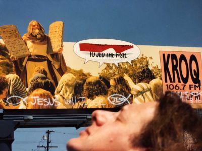 Vandalized KROQ billboard, Jed in foreground