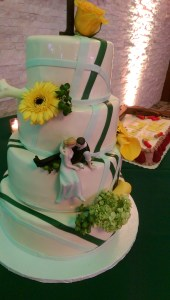 Uplighting helps to bring out the colors in the wedding cake