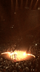 "Madonna plays acoustic guitar during her performance of ""Ghosttown"" at Chicago's United Center."
