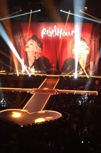 A national DJ serves as the opening act while fans await the main act at Madonna's Rebel Heart show.
