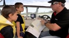 Nigel teaching his kids the rules in marine parks ©James Sherwood - Bluebottle Films