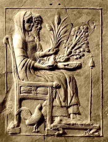 ديميتر ممسكة بحزمة من نبات القمح
