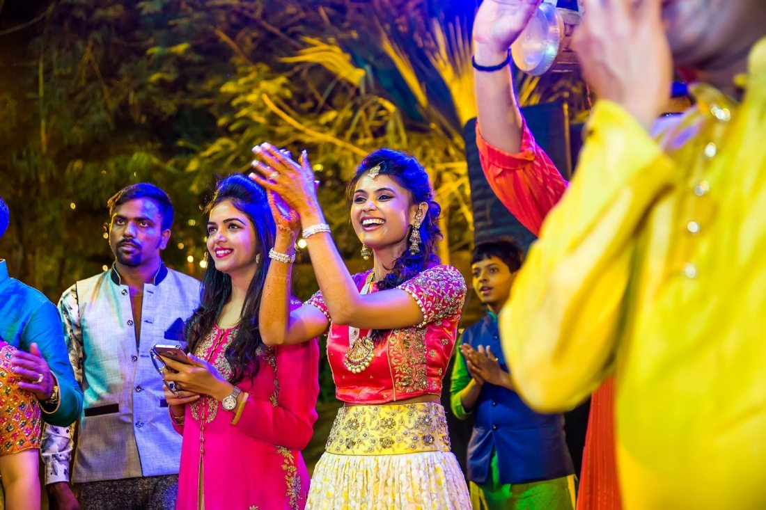 Colorful mehendi sangeet wedding photography Ahmedabad