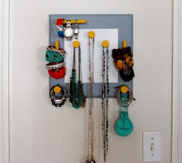 Wooden painting that we converted into an accessory holder