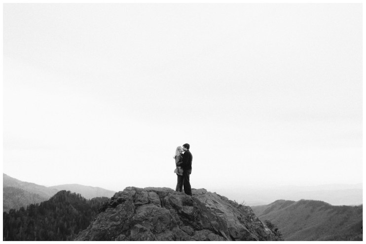 kissing-on-mountain-side-charlies-bunion-engagement-Jill and Daniel