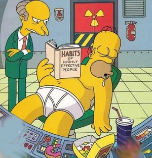 Homer Simpson resembles me I think...