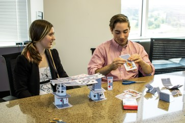Scholarship recipients Jake & Katherine think out of the box to build a bridge out of cards.