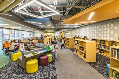 "The library acts as a ""learning corridor"". Space is not differentiated between circulation and the media center, instead they blend together and become a functional learning space."