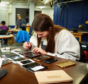 Image of student repairing cell phones