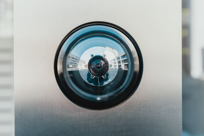 photo of a peephole on a gray door