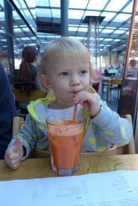Olivia drinking freshly pressed carrot juice