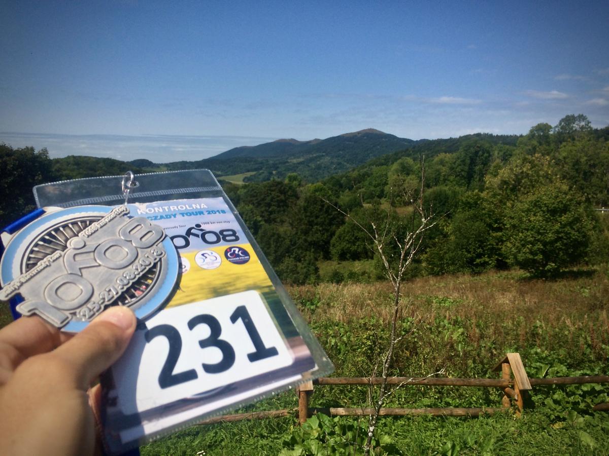 Karta kontrolna i medal po maratonie kolarskim